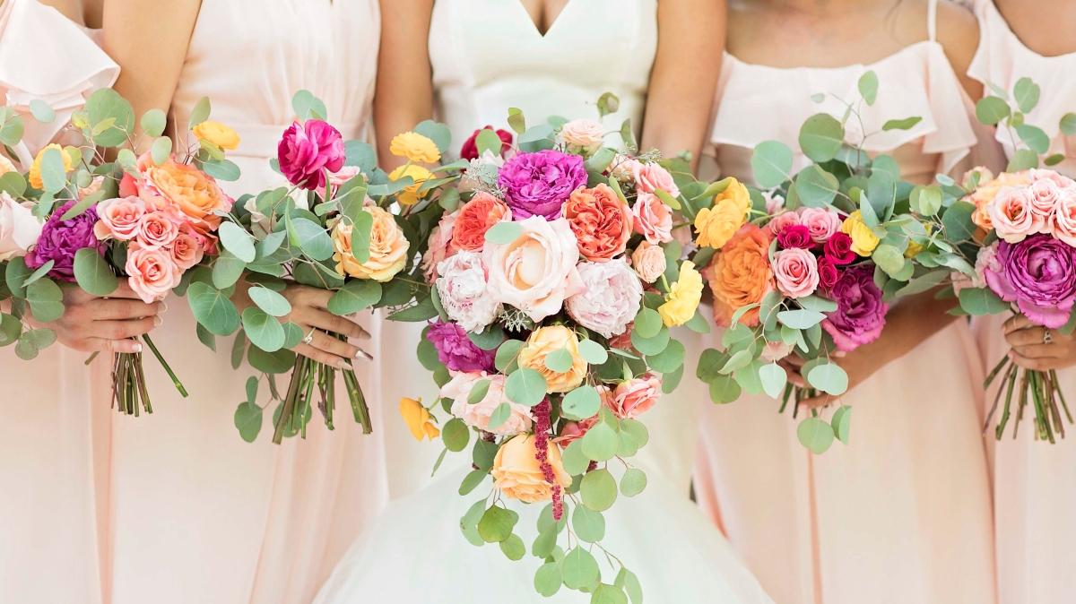 A bright and vibrant Latin-inspired wedding at the Venue Chattanooga, Chattanooga Wedding Flowers, Lang Floral Designs Photo Credit: KC Photography